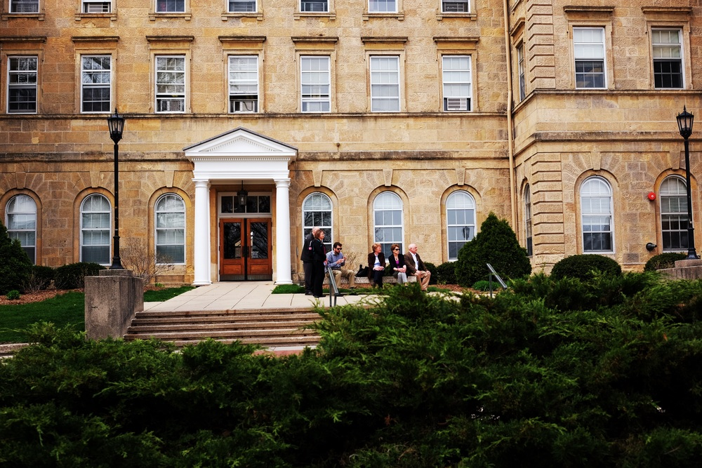 Dean of Students Lori Berquam, Provost Sarah Mangelsdorf, and others observe from afar just outside their offices in Bascom Hall.