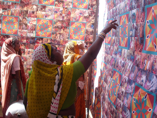 women of partapur identifying their pictures amongst the collage.jpg