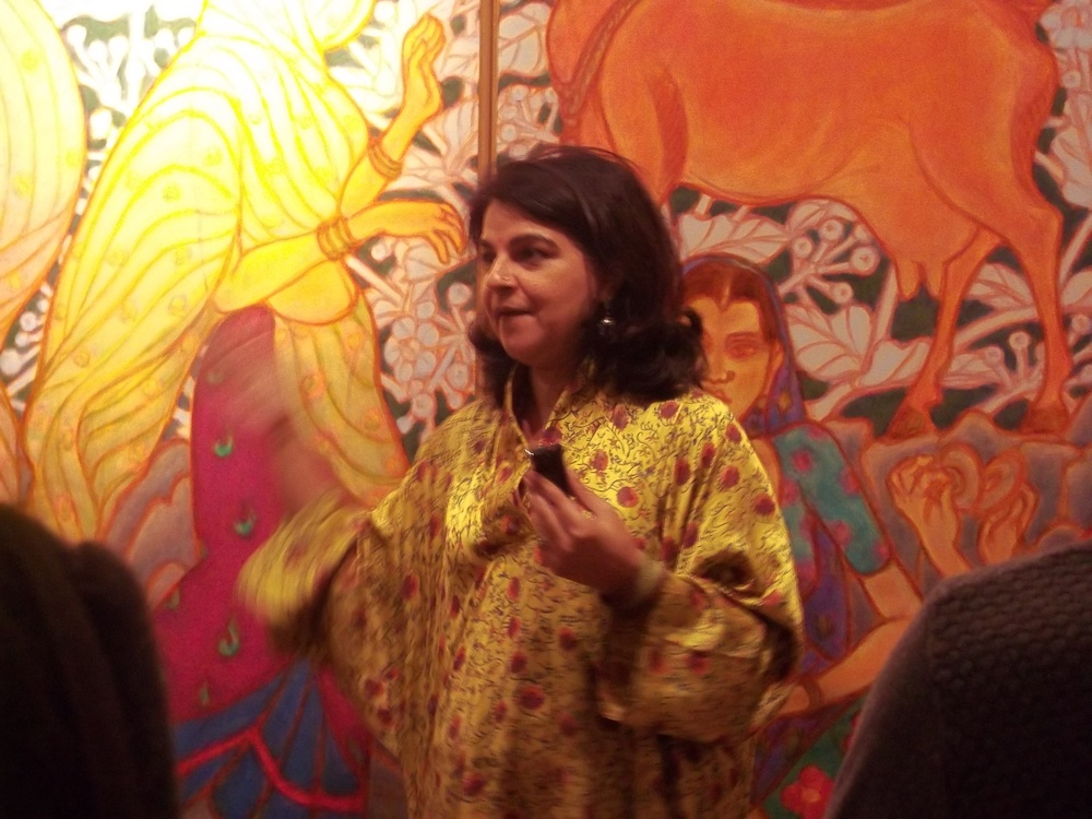 Manisha Gera Baswani taking the group on a walk through of Ramachandran's exhibition at LKA