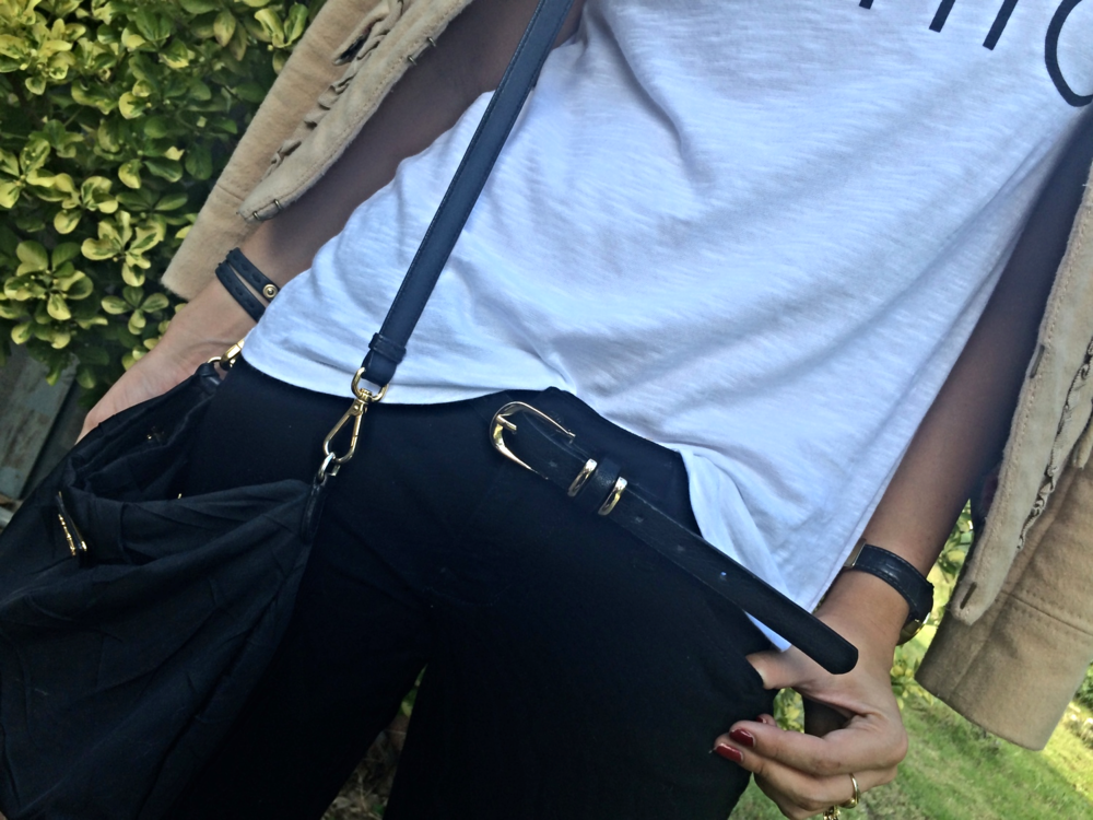Tailored yet forgiving black cigarette pants with a black leather belt. Paired with an oversized tee for the perfect balance of comfort and chic.