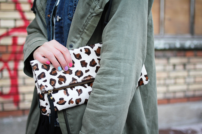 Leopard clutch and rainbow pastel nails