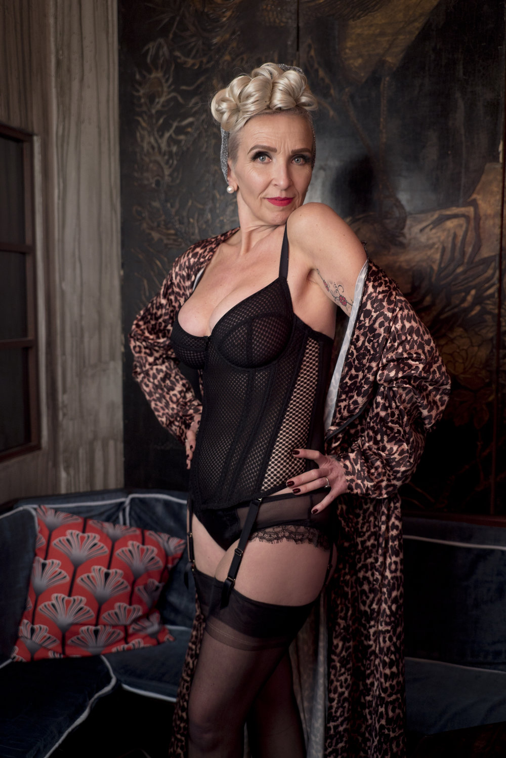 Karen wears the  Carlota Basque ,  Isadora Brief  and  Bettie Page Leopard Robe