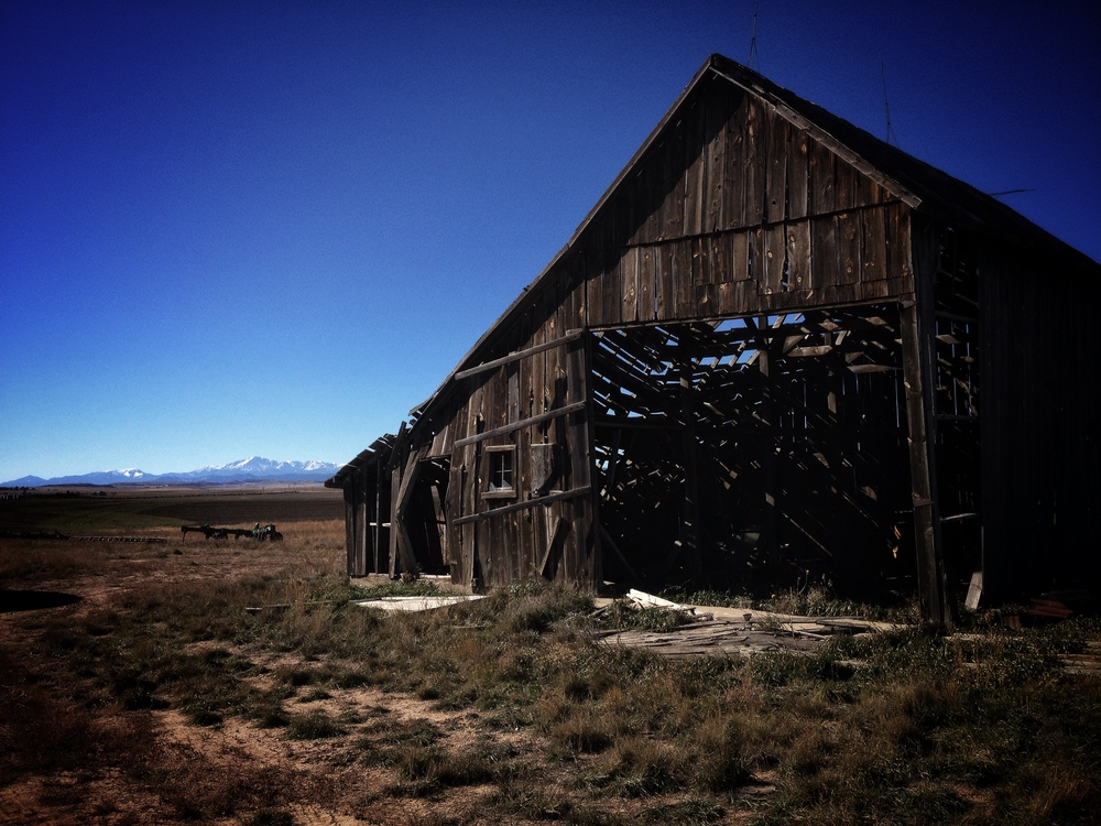 Cell phone, reference shot of an old barn with Pikes Peak in the background.