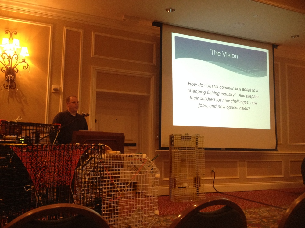 Principal Todd West explains the Eastern Maine Skippers Program during the Fishermen's Forum