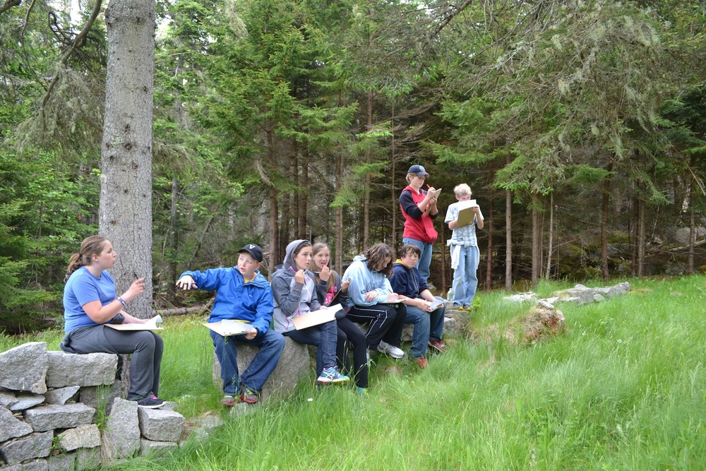 VH students sit in at the foundation of the old catholic church and make observations and educated guesses about what else might have been in this area during the quarry era