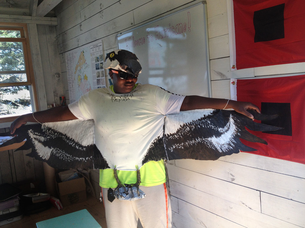 Students also enjoyed some silly moments trying on bird costumes (like the Osprey in this photo) to learn more about how different birds are adapted to the environment that they live in.