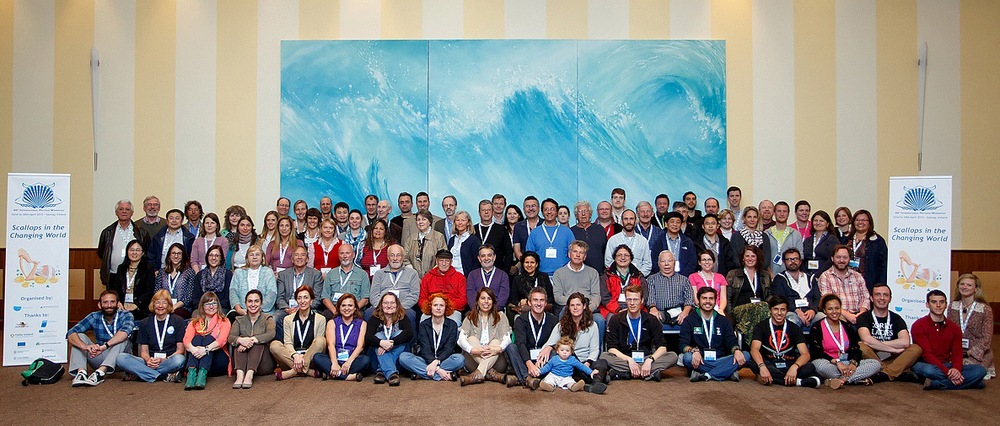 A full group photo from the conference (I am hiding in the back row at the left edge of the blue background)
