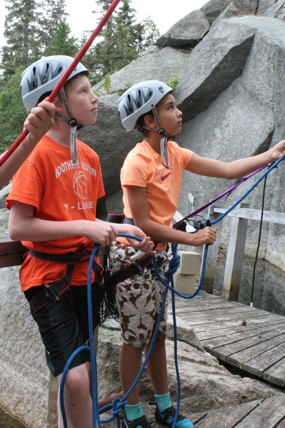 Focused belay team at the rock wall