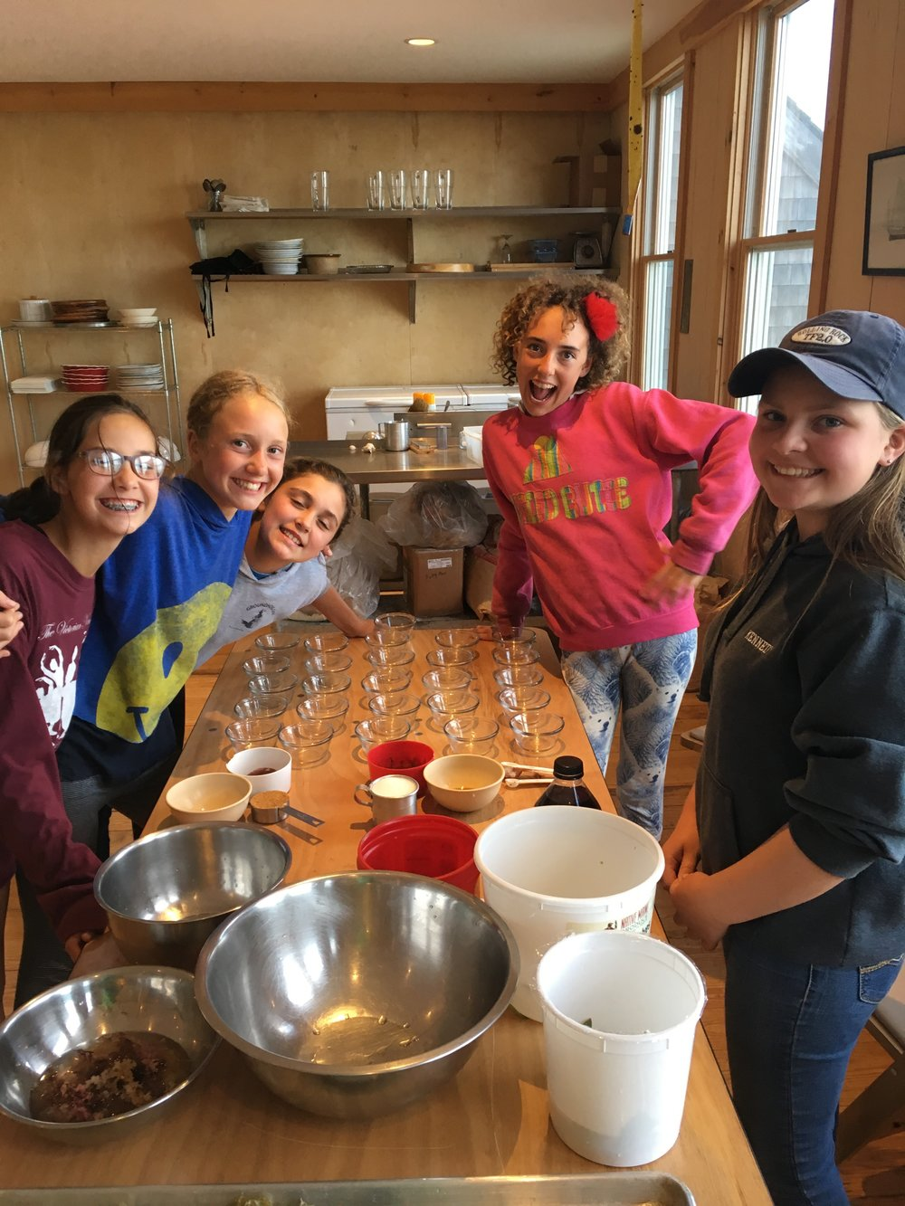 Our Middle School Island Ecology students preparing to pour their pudding thickened with the carrageenan boiled out of the Irish Sea Moss they had foraged into ramekins before letting it sit and set before consumption.