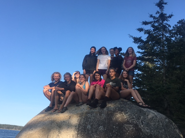 HSMB students taking a break from their work at Sandy Beach