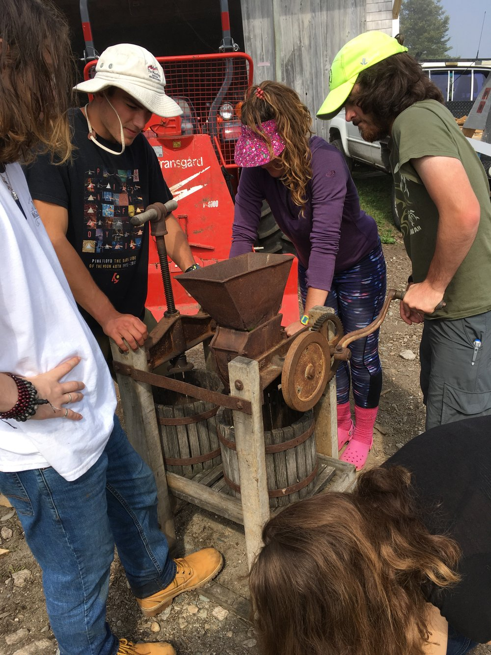 Students operate the cider press!