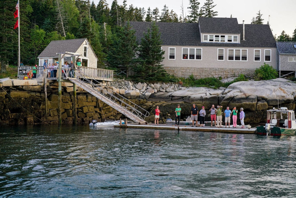 July 2016: Staff, board, and friends bid farewell to guests from the dock. Photo Credit: Michael Hawley.