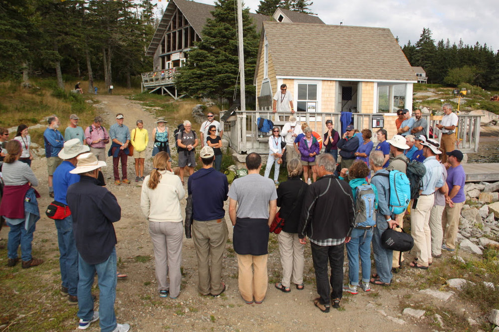 Sam and I (at left), along with other staff and board, greet guests on Hurricane Island at Outward Bound's 50th reunion, August 2014.