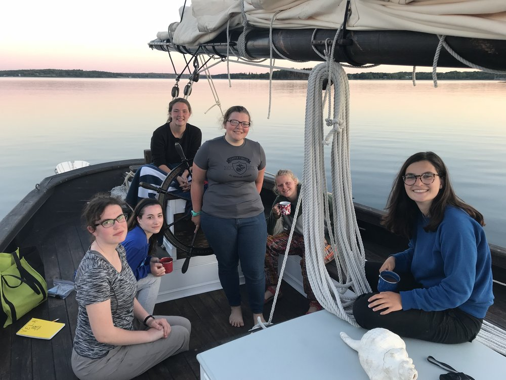 The first half of the group to sail aboard the Vela, enjoying a beautiful sunset.