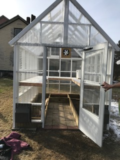 Photo of the finished greenhouse, in time for starters of kale and mesclun salad mix.