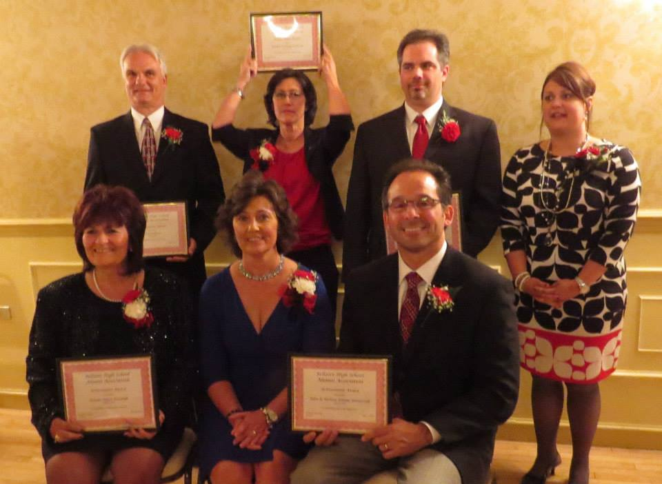 Receiving Achievement Awards at the 2014 banquet were (pictured front) Rosalie Rigas Kovalyk '74-Business, John'79 and Melissa Palian Rataiczak '79-Civic, (back) Kim Clifford '72-Sports, Joanne Cochran Sullivan '71-Arts, and Brian Kurko '94-Science & Medicine. This award was presented by board member Misty Tedeschi Forgacs '91.
