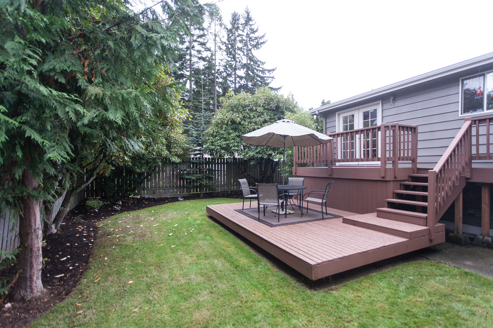 ...a lovely tiered deck for BBQ's and summer-living that overlooks a fully-fenced back yard.
