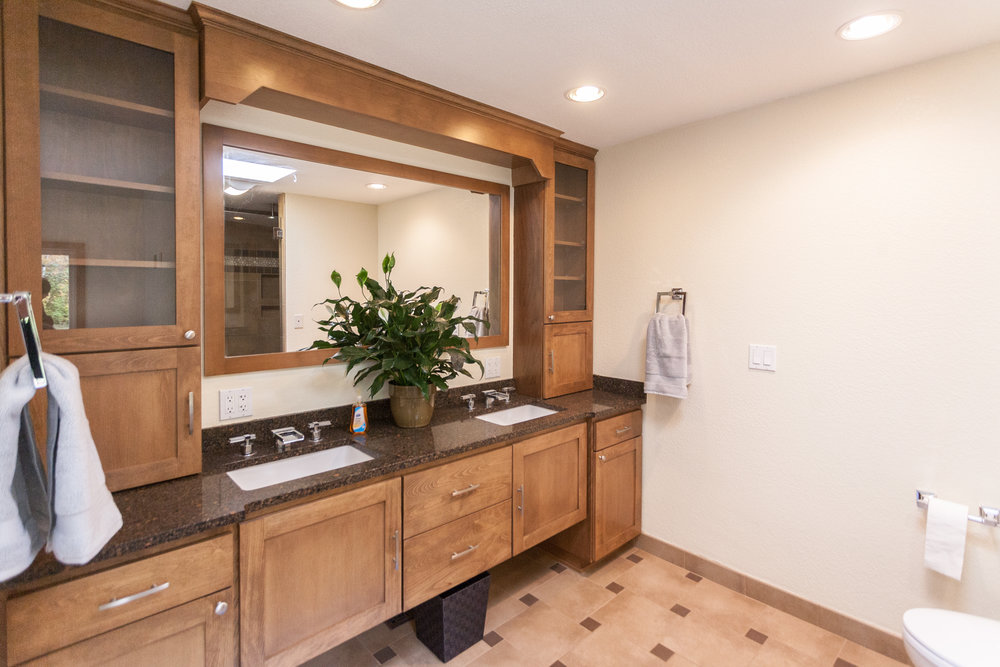 Dual-vanity in the master-bath. Notice the faucet fixtures and ample linen storage.