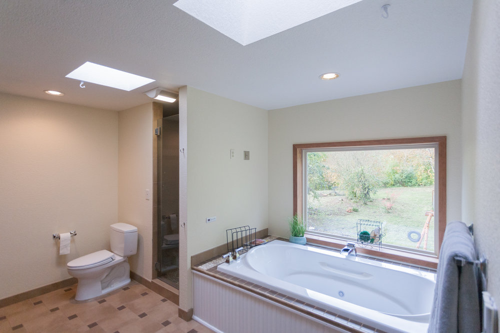 Master-bath with heated floors, wired for electronics, jetted Bain tub, skylights, and waterfall shower.