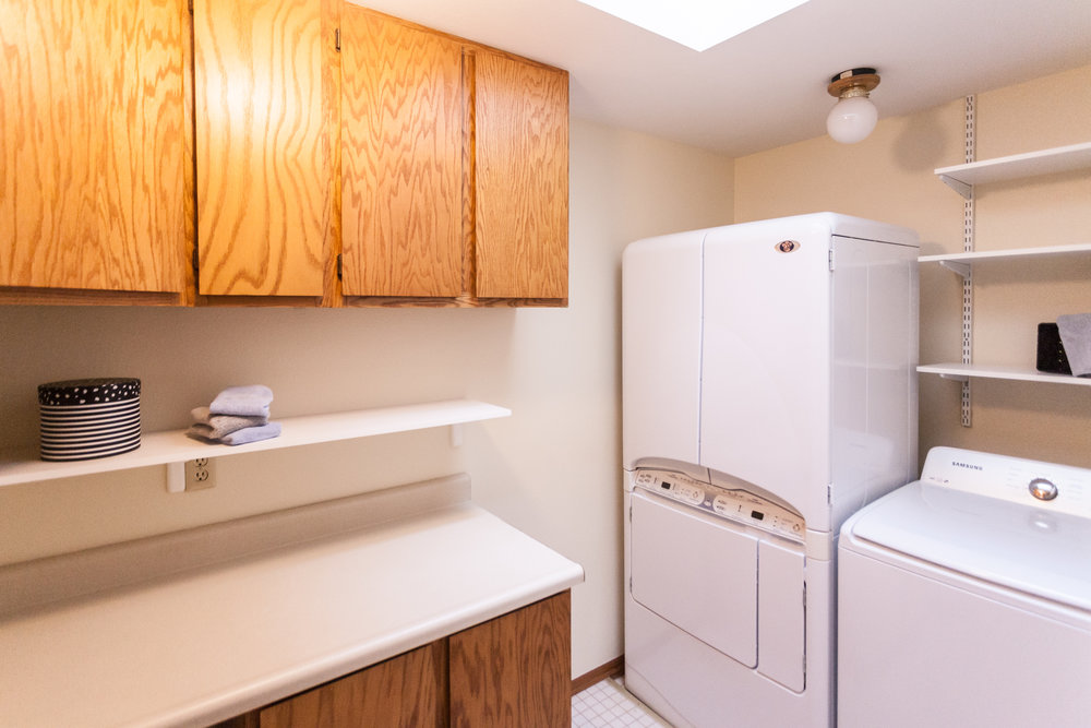 Dedicated laundry-room. Dryer with a stand-up dryer section is an extra bonus. Just outside the master-bedroom and the two additional bedrooms. No traipsing down to the basement for laundry. 3 bedrooms on the upper floor.