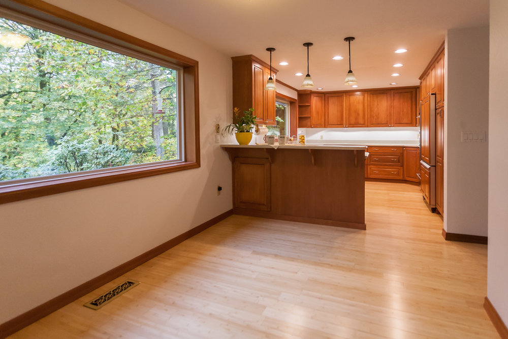 Kitchen has it all. Stainless appliances. Corian countertops. No Ikea cabinets here! Full wood and special-ordered. Look out at the trees and yard from every window in the house...especially at the kitchen sink!