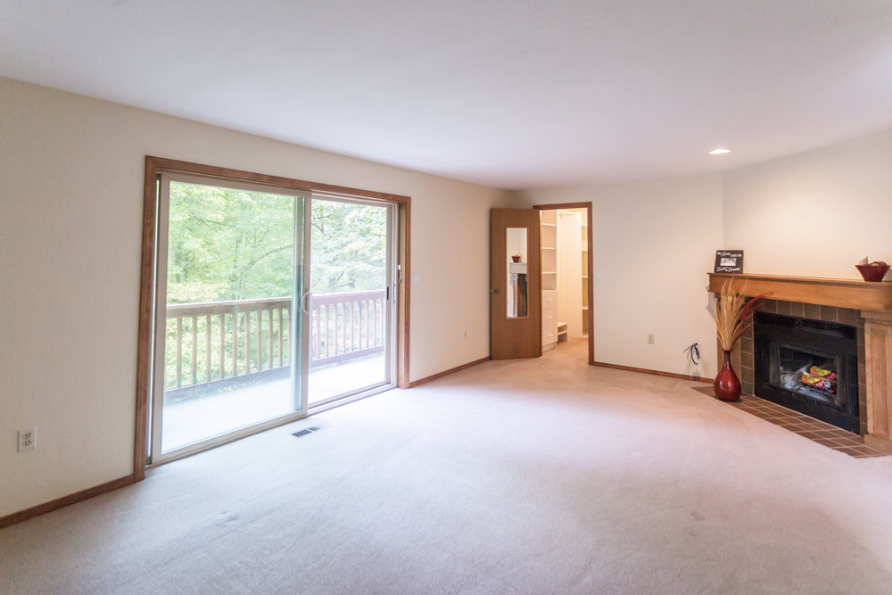 Master-bedroom with sitting balcony, fireplace, walk-in closet and room for much more.