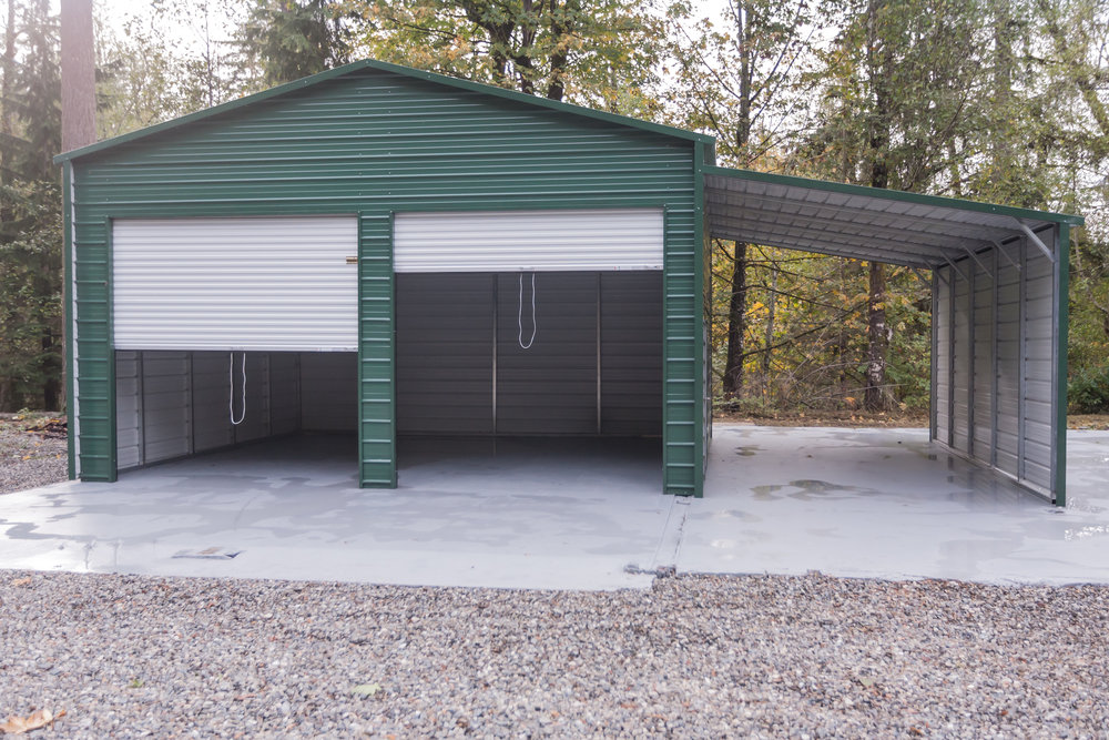 Newly built 2-car garage with overhang. RV parking. Shop? Electricity run to area and ready for your hook-ups.