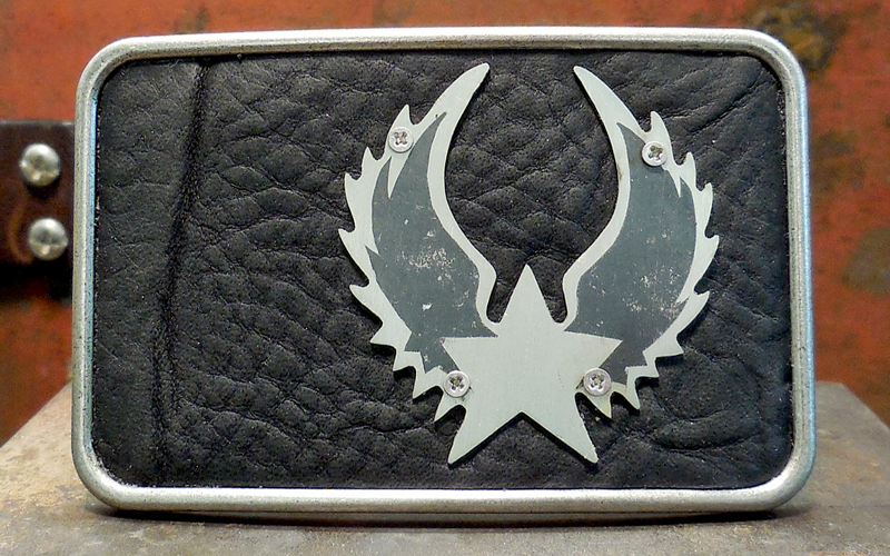 Lone Star Wings Belt Buckle  Brushed silver buckle with Black Leather Top and Silver Lone Star Wings with black detail.  $75