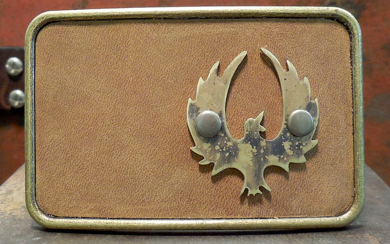 Phoenix Belt Buckle  Brushed brass buckle with brown leather top and oxidized brass Phoenix. $75