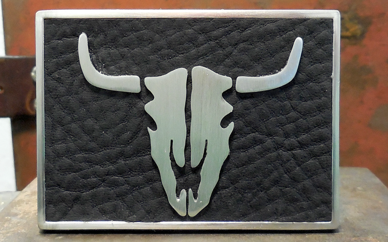 Bull Skull Belt Buckle  Silver buckle with black leather top and silver bull skull. $80