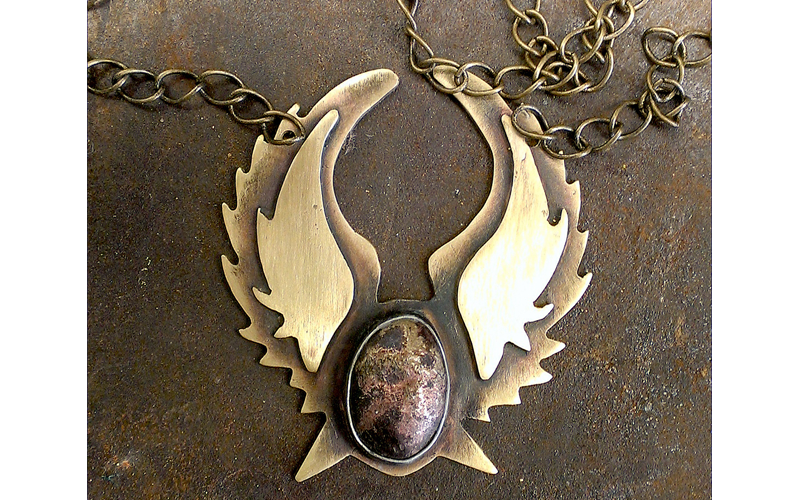 Brass Lone Star wings with a Brass Stone on a brass chain $85