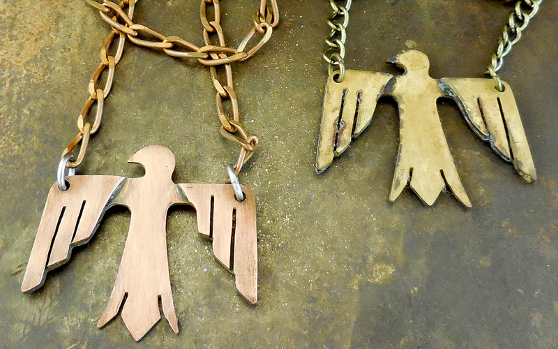 L :  Copper Thunderbird on a vintage copper chain. / $85  R : O xidized brass Thunderbird on a brass chain. / $85