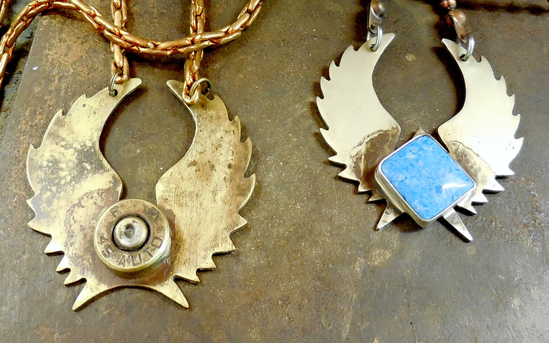 L :  Oxidized brass Lone Star with a Brass bullet shell front on a vintage copper chain. / $85  R :  Silver Lone Star with a square blue stone on a copper chain. / $85