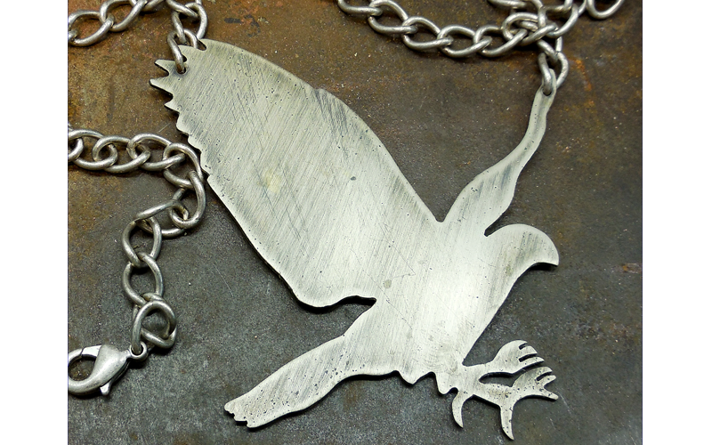 Brushed Silver Hawk on a silver chain. $85