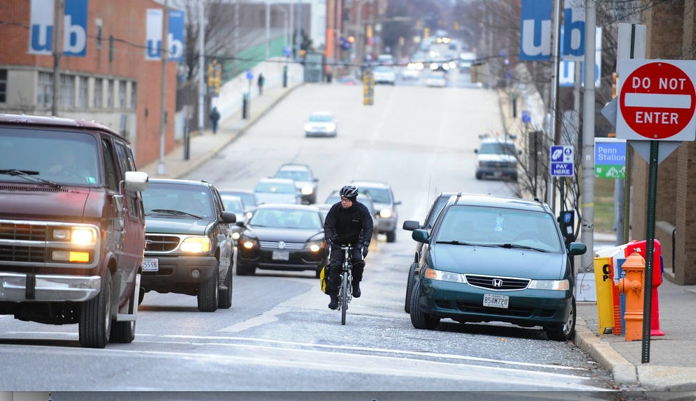 A bicyclists rides down Maryland Ave. Photo Credit: Baltimore Sun