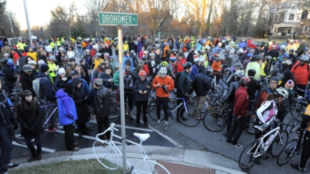 Hundreds of people on bikes gather to pay tribute to Tom Palermo. Photo Credit: Baltimore Sun