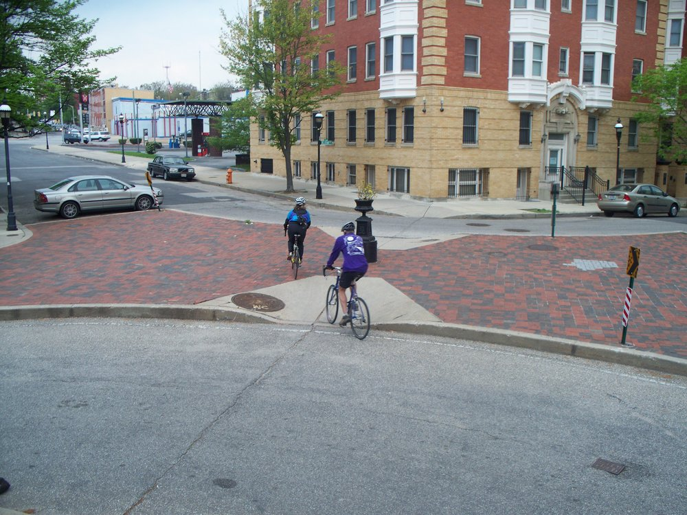 Neighborhood cut-throughs, like this one on the Madison Ave bike boulevard in Baltimore, allow bikes to cut from street to street but divert and reduce car through-traffic.