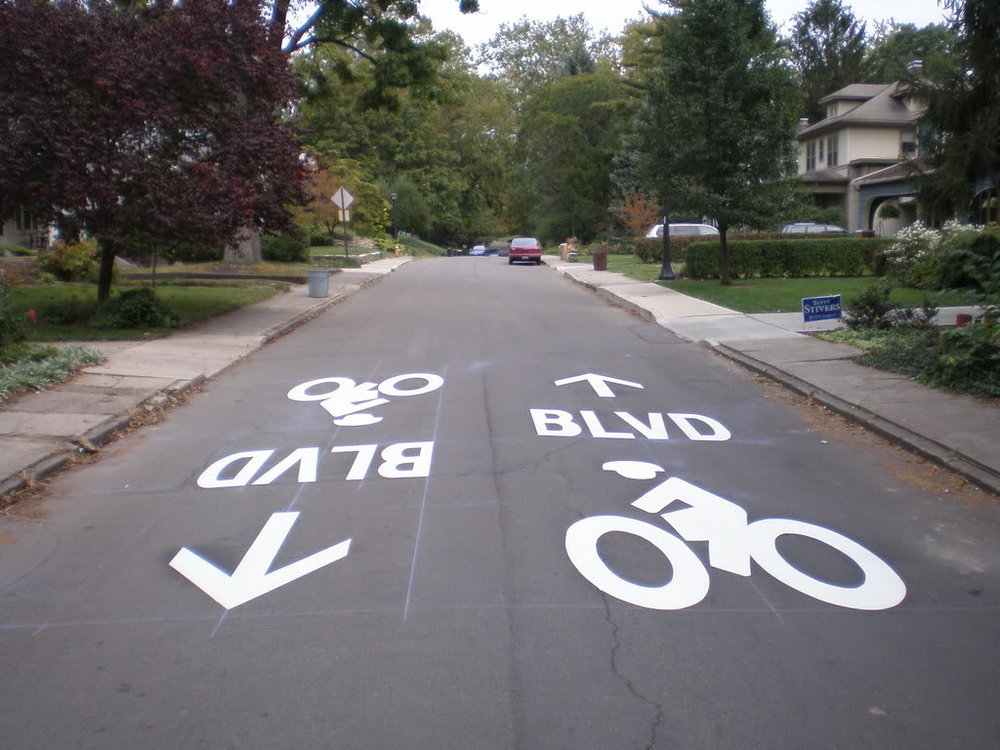 Prominent bicycle markings, like these in Columbus, direct riders on bike boulevards while reinforcing that bikes belong in the street.