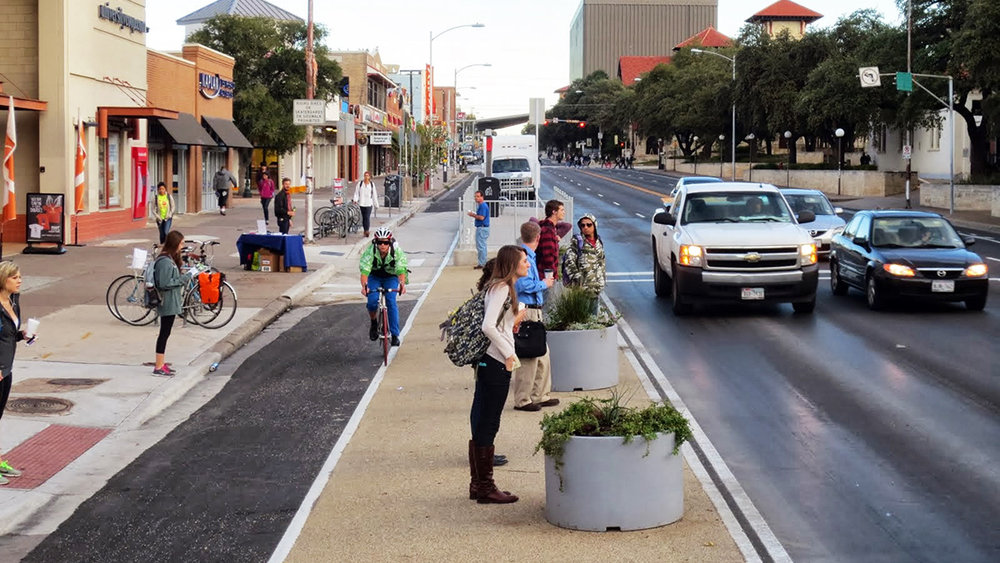 Separated bike lanes on Guadalupe Street in Austin, TX. Photo courtesy of the Plantizen, City of Austin.