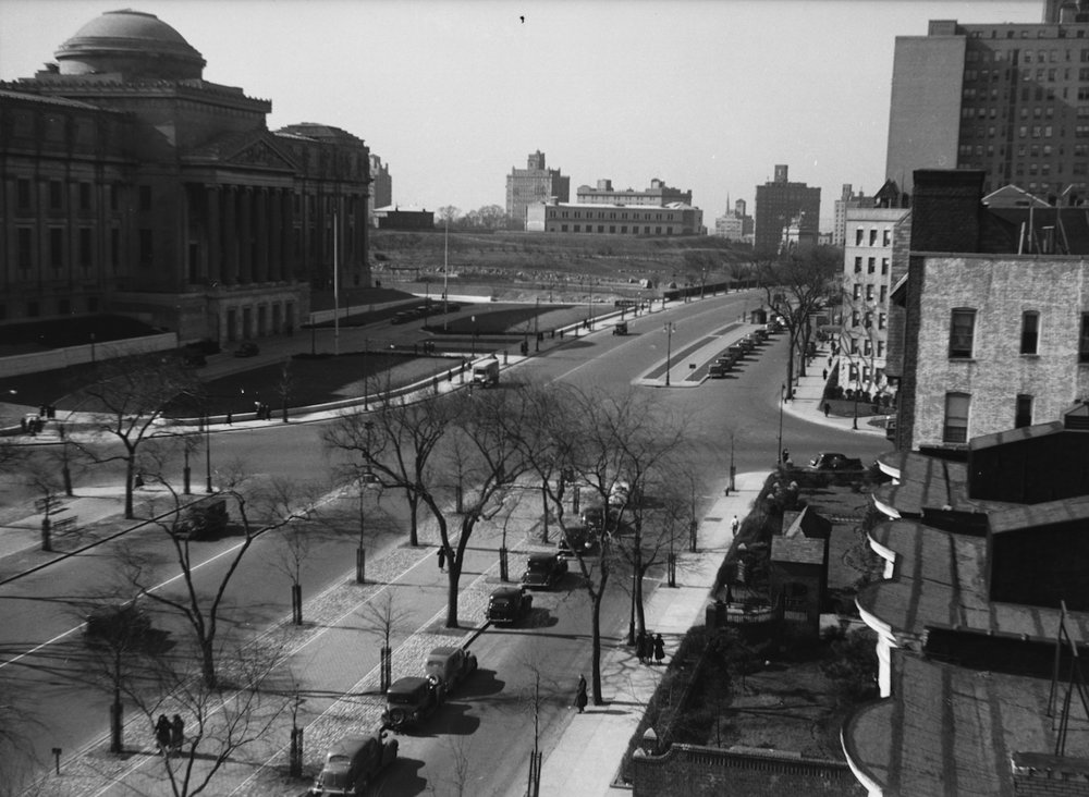 The Olmsted Designed Eastern Parkway in Brooklyn in the 1930's with a multi-use median path for people walking and biking.
