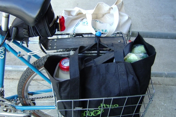 Baskets that attach to a back rack are the perfect size for reusable grocery bags, and they usually fold down so you can always keep them on your bike.