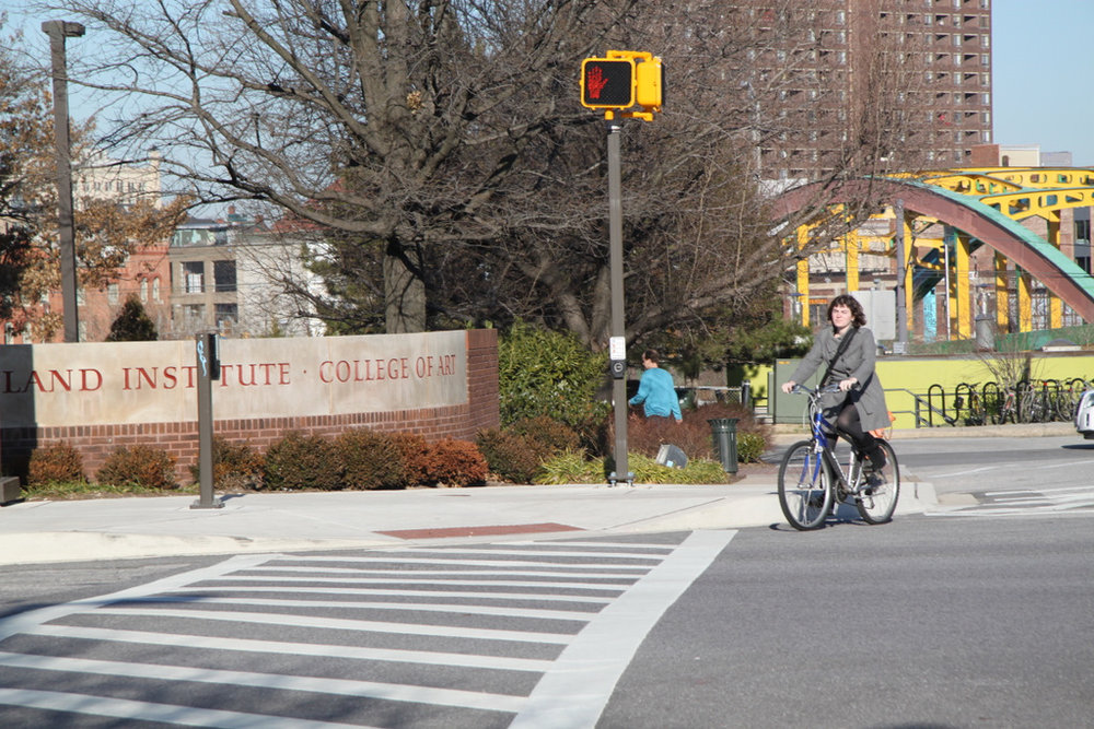 A person riding a bike crosses Mt. Royal. Photo Credit: Fern Shen-Baltimore Brew
