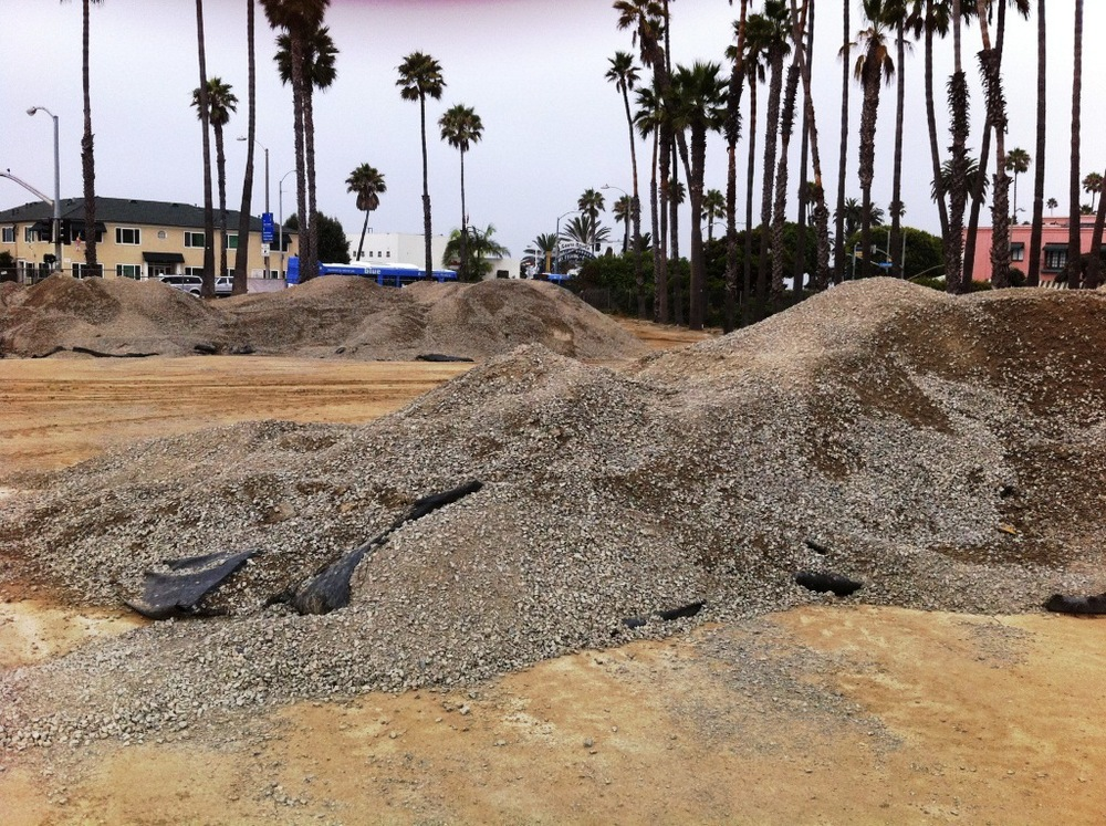 The parking lot surface was torn up and put into mounds.