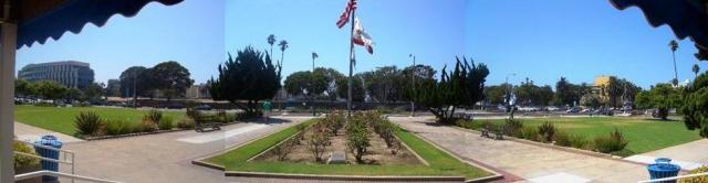 Looking west from the City Hall lawn towards the rest of the project site across Main Street. A rose garden is located directly in front of City Hall.