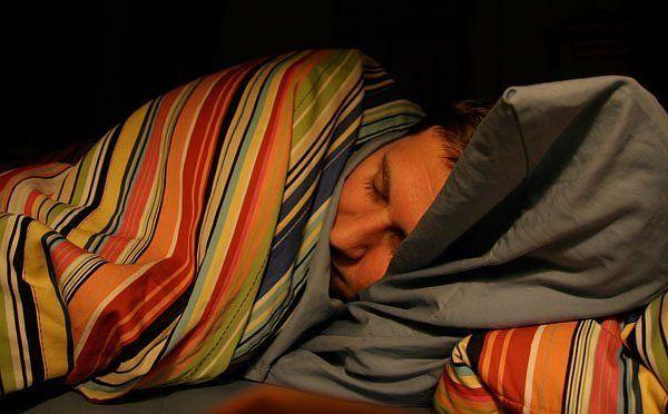 boy hiding under covers.jpg