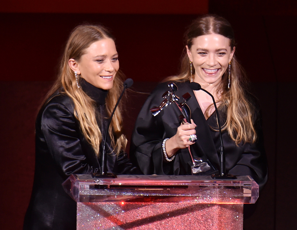 Mary Kate and Ashley Olsen accepting their award for Womenswear Designer(s) of the Year for their line The Row. The twin duo also won for womenswear in 2012 and accessories in 2014. image via Bustle.com