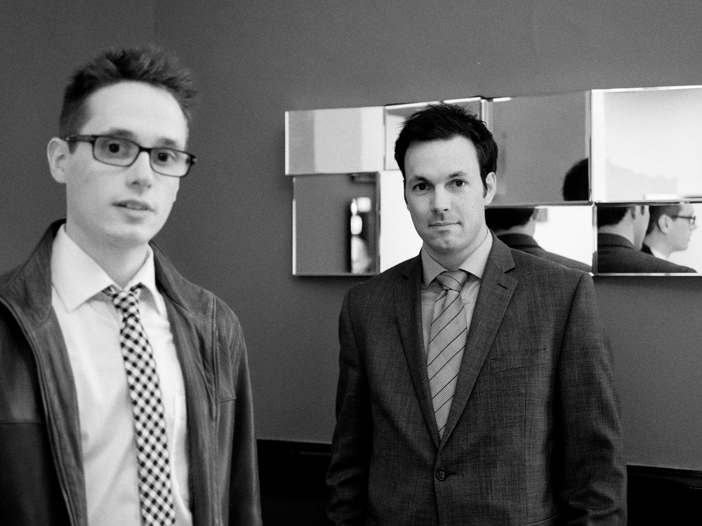 Business Regina Magazine photoshoot. Devin Pacholik and Paul Huber looking out at you from the picture. Take a good look at the image. In seven days you will die.