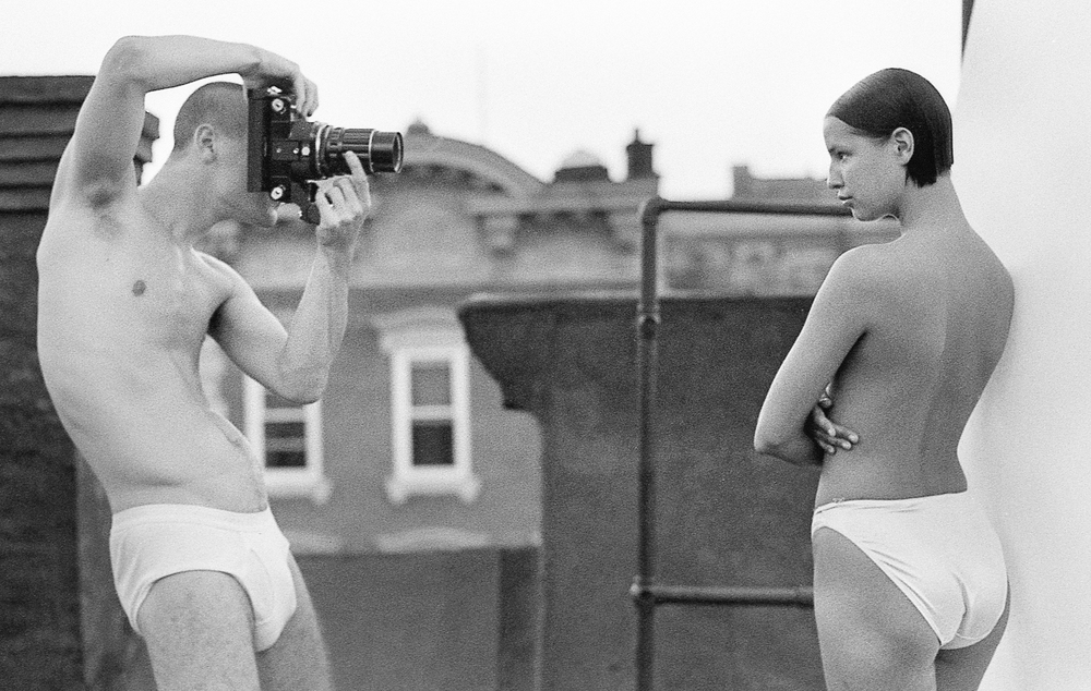 Patrik Andersson photographing Anna Tamander on a roof in East Village    PH:Jesper Haynes