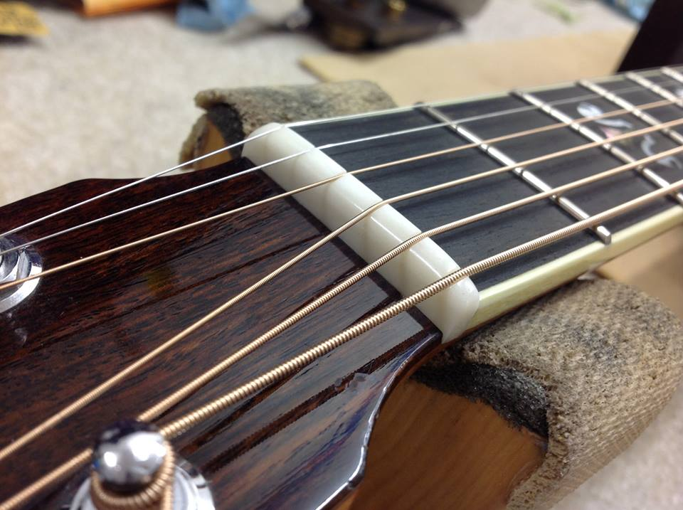 New bone nut on acoustic guitar