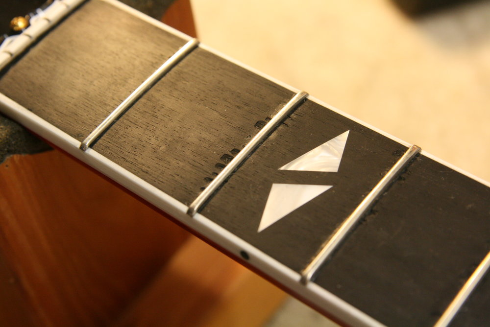 Fretboard repair/ Guitar repair